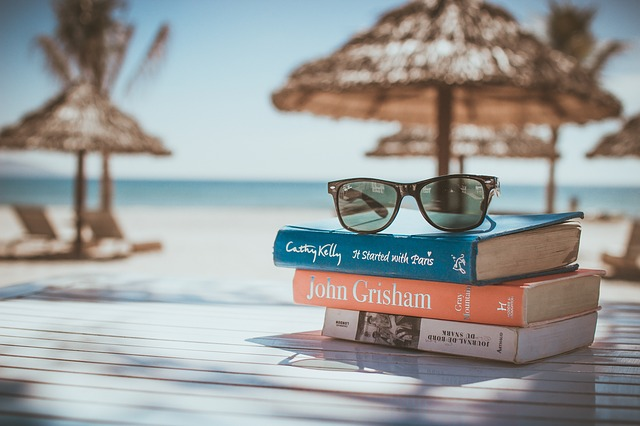 Stack of books at the beach