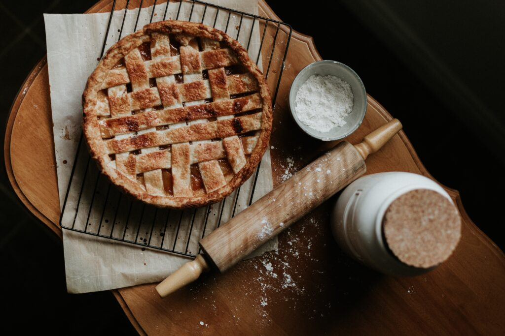 Lattice crust pie with rolling pin next to it