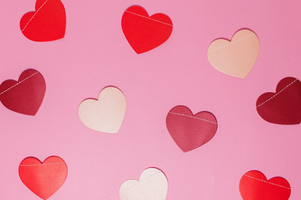 Paper hearts on a pink background