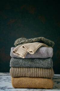 Pile of folded sweaters