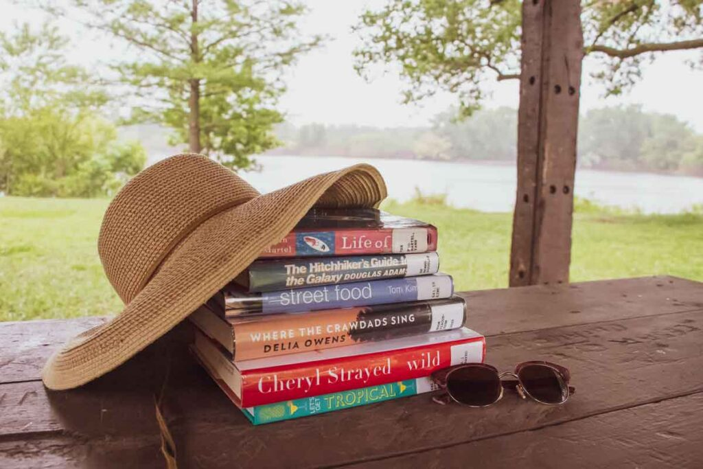 Stack of books by the lake